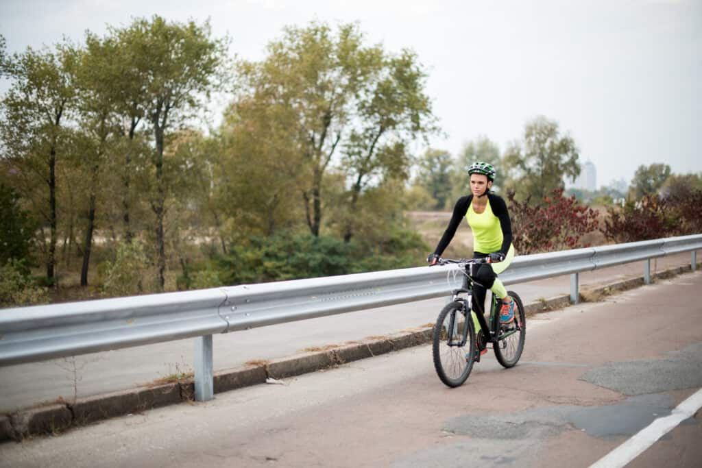 Woman cycling on road best bike saddle