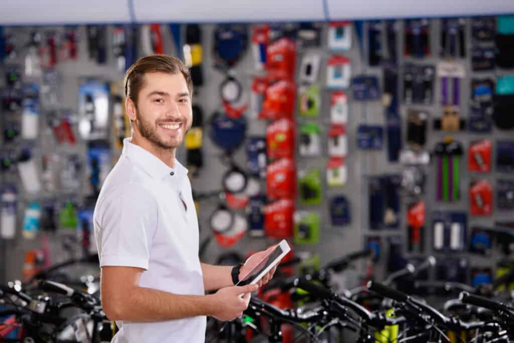 Man preparing to give professional fitting for Best male bike saddle