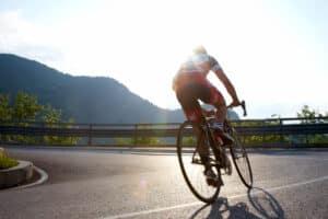 Man on road bike best road bike saddles for men