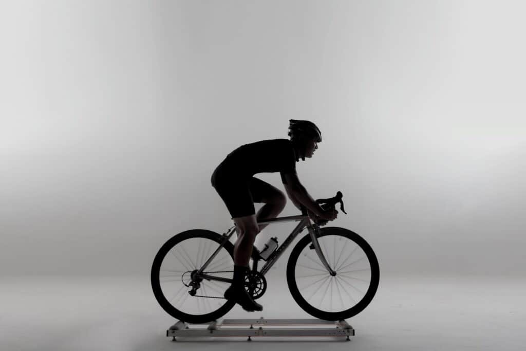 Image of man riding on best bike rollers