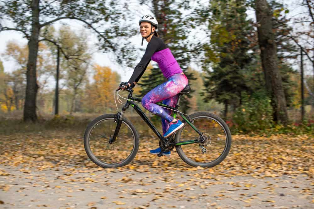 image of woman in park wearing best cycling baselayer for women